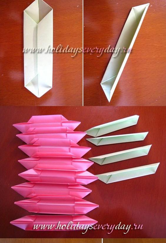 Tiếp theo để làm lá bạn cũng gấp tương tự . Đồng thời để kết chúng lại với nhau thì lúc này ta cần có dây nịt. Lấy ghim và cột 4 cụm cánh hoa với nhau bằng kẽm – nếu không có kẽm bạn có thể thay thế bằng dây chun.