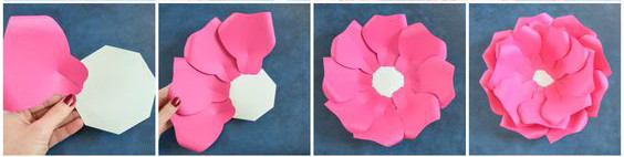 Sau đó dùng keo gắn cánh hoa theo hình vòng cung từ ngoài vào trong trên đế đã tạo sẵn trước đó.