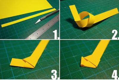Cắt giấy màu thành dây dài. Buộc thắt nút lại. ép xuống cho thành nếp gấp góc còn thừa lại.
